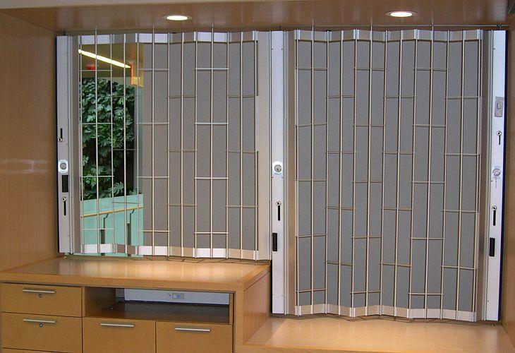 Flexiglide classic chainlink sliding folding security shutter