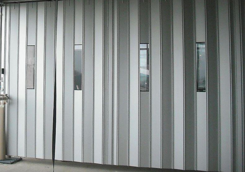Sliding Security Shutters : Flexiglide protector sliding folding shutter