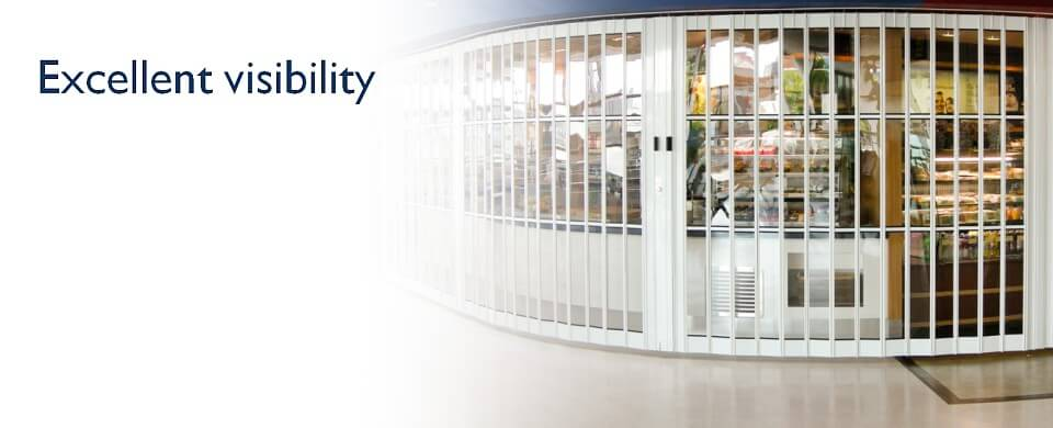A sliding security grille with clear glazed panels