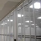 Detail of a Vision Air sliding folding security shutter at ceiling level.